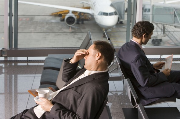 Can flying really give you a headache?, airplane headache, travel sickness, travel health
