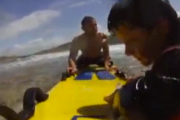 Video: Surfboard camera captures rescue of boy caught in rip-tide