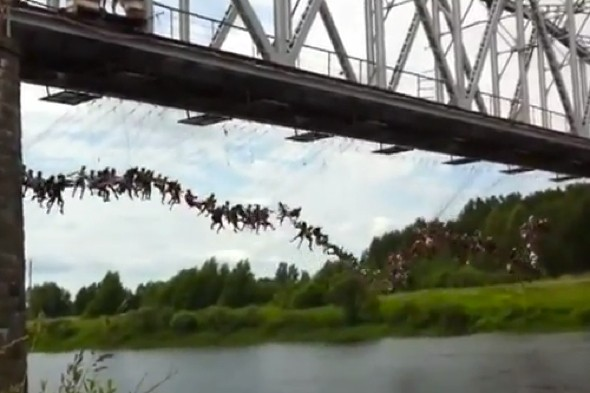 Watch: 135 people perform mass bridge bungee jump