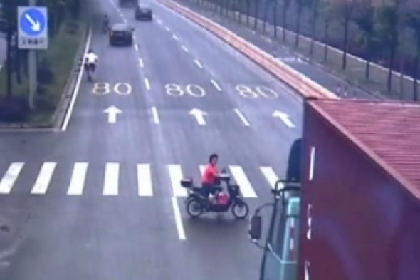 Watch: Female cyclist has very escape in lorry crash