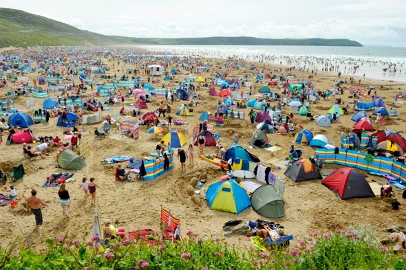 Wettest summer on record? But holidaymakers still hit the beach