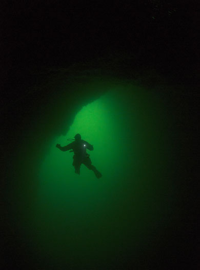 A diver in the arch at Sgarbhstac in St Kilda