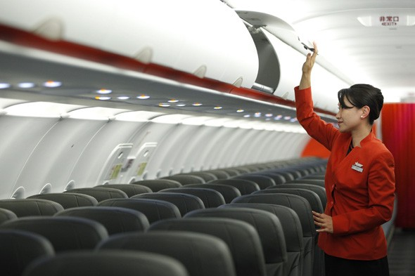 Take photos up the skirt of an air hostess