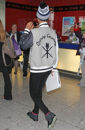 Which girl dressed like a boy as a disguise at Heathrow Airport?