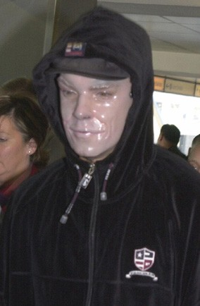 Can you guess who is wearing a scary mask to stay hidden at Heathrow?