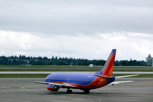 Man arrested for 'watching porn and fondling himself' mid-flight