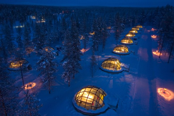 Gaze at the Northern Lights from a glass igloo in Finnish Lapland