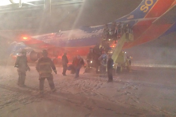 Terror as plane carrying 125 people slides off snowy runway