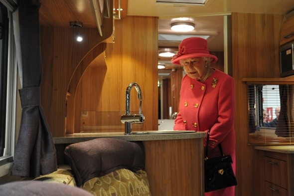 Where would one put the corgies? Queen goes glamping in luxury caravan