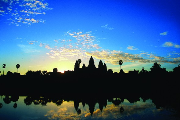 Watch the sunrise over Angkor Wat