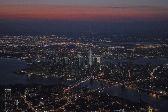 Can you name this brightly lit city that 'never sleeps'?