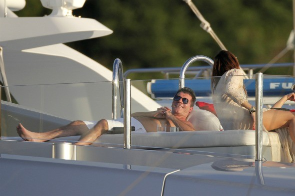 Simon Cowell escapes to the Caribbean for 25 days!