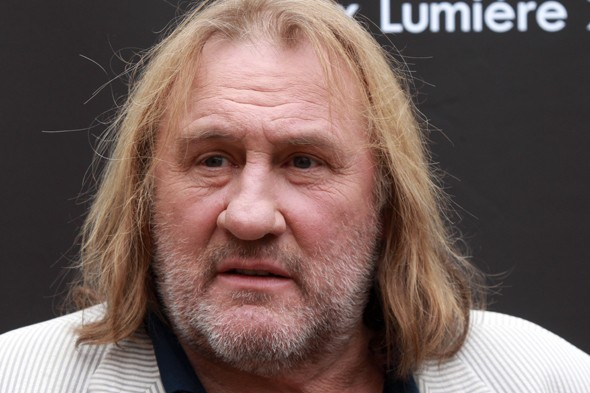 Gerard depardieu to 'give up French passport'