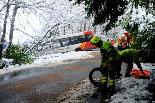 School bus carrying 20 children slips off road down embankment in Wales