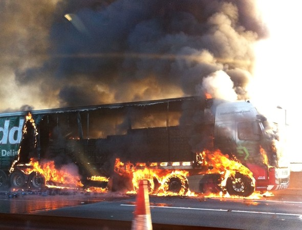 Rush hour chaos as Eddie Stobart lorry bursts into flames on motorway