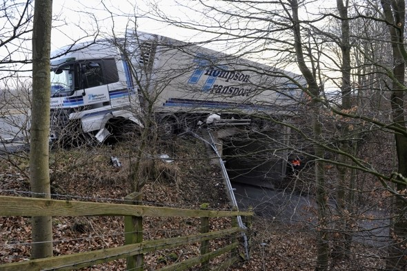 Lorry left hanging over bridge on UK motorway