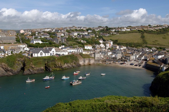 Which comedy drama about a tactless doctor is set in this pretty fishing village in England's South West?