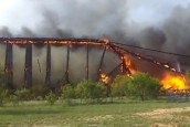 Video: Burning railroad bridge collapse caught on camera in US