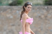 Chloe Sims frolics on the beach in Cannes