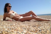 Melanie Sykes soaks up the sun in bikini on a beach in... Dorset?