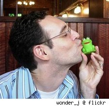 Man kissing toy frog