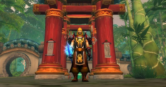 A picture of a death knight from the Mists of Pandaria beta, standing in front of a pagoda in a bamboo forest.