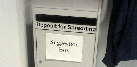 A paper shredder labeled