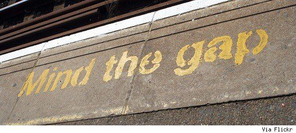 A subway sign warns you to mind the gap