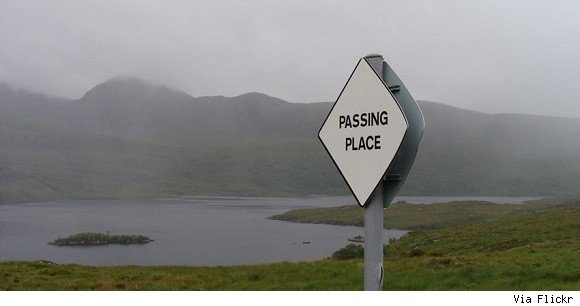 A sign near a lake that reads,