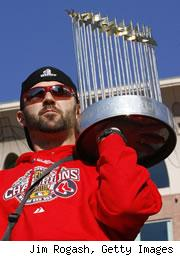 Jason Varitek holds the World Series trophy