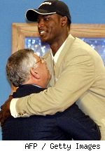 Kwame Brown hugs David Stern