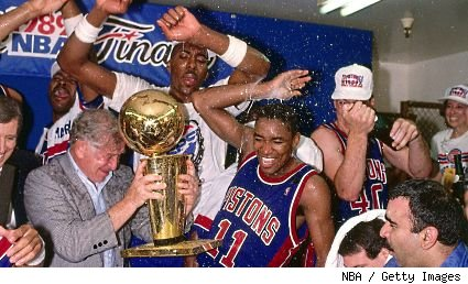 Bill Davidson, John Salley and Isiah Thomas celebrating