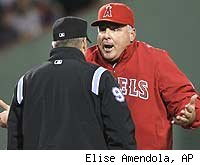 Umpire Tim Timmons and Angels manager Mike Scioscia