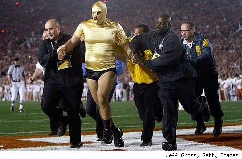 Masked BCS invader is escorted away by security