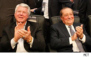 Jimmy Johnson and Bob Arum applaud during the undercard