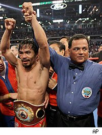 Manny Pacquiao celebrates his victory over Joshua Clottey
