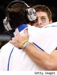 Tim Tebow hugs Urban Meyer