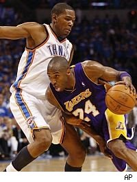 Kobe Bryant tries to drive on Kevin Durant