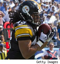 Troy Polamalu makes an interception in the end zone