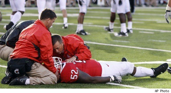 Eric LeGrand receives treatment on field