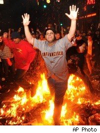 Giants fan runs through bonfire during celebration