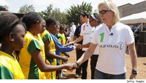 Martina Navratilova greets children before her climb of Kilimanjaro