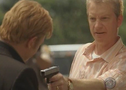 Horatio Caine with a gun pointed at him.