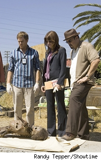 Dexter, Deb, and Angel examine a skeleton.