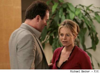 Gina Russo (Jessalyn Gilsig, right) re-enters Christian's life when she learns Michelle will be Wilbur's adoptive mother.