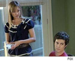 Reeser, with her co-star Adam Brody, in a scene from 'The OC.'