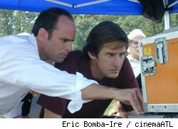Walton Goggins and Ray McKinnon look over some footage on the set of Randy and the Mob.