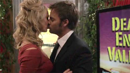 Brian (Barry Watson) and Stephanie (Stacy Keibler) share a kiss at her independent film premiere.