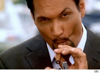 Jimmy Smits lights a cigar