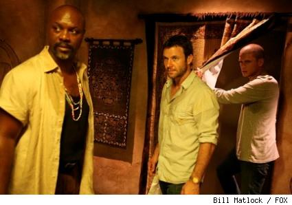Lechero (Robert Wisdom, L), Whistler (Chris Vance, C) and Michael (Wentworth Miller, R) re-emerge into Lechero's lair from the hidden tunnel in PRISON BREAK.